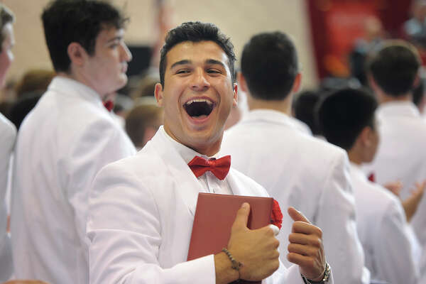 Graduate Michael Piroli celebrates after receiving his diploma at Fairfield Prep's 75th Commencement Exercises at Fairfield University's Alumni Hall in Fairfield, Conn. on Sunday, June 4, 2017