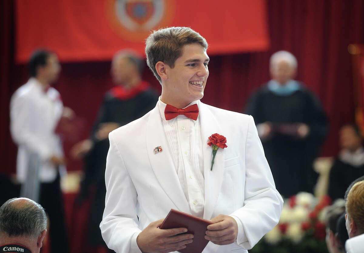 Graduate Nicholas Mirabile smiles after receiving his diploma at Fairfield Prep's 75th Commencement Exercises at Fairfield University's Alumni Hall in Fairfield, Conn. on Sunday, June 4, 2017.