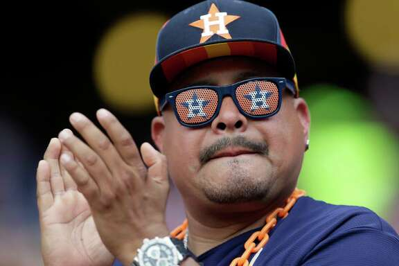 A Houston Astros fan cheers on his team in the fifth inning of a baseball game against the Texas Rangers, Sunday, June 4, 2017, in Arlington, Texas. (AP Photo/Tony Gutierrez)