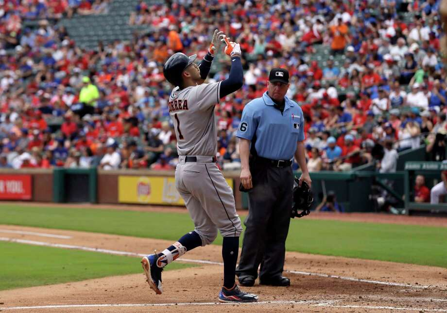Houston Astros' Carlos Correa celebrates his solo home run at the plate as umpire Ryan Blakney watches in the third inning of a baseball game against the Texas Rangers on Sunday, June 4, 2017, in Arlington, Texas. (AP Photo/Tony Gutierrez) Photo: Tony Gutierrez, Associated Press / Copyright 2017 The Associated Press. All rights reserved.