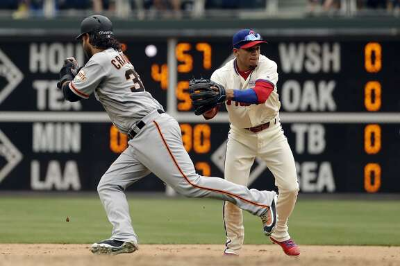 Philadelphia Phillies second baseman Cesar Hernandez, right, tags out San Francisco Giants' Brandon Crawford on a double play during the seventh inning of a baseball game, Sunday, June 4, 2017, in Philadelphia. (AP Photo/Matt Slocum)