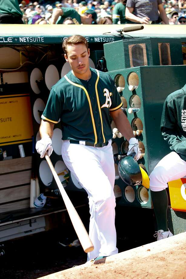 OAKLAND, CA - APRIL 23: Matt Olson #28 of the Oakland Athletics stands in the dugout during the game against the Seattle Mariners at the Oakland Alameda Coliseum on April 23, 2017 in Oakland, California. The Mariners defeated the Athletics 11-1. (Photo by Michael Zagaris/Oakland Athletics/Getty Images) Photo: Michael Zagaris, Getty Images