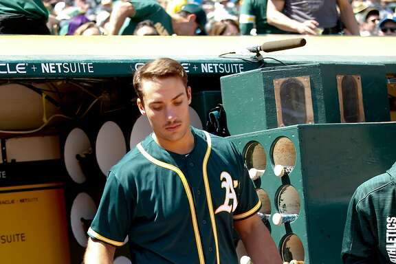 OAKLAND, CA - APRIL 23: Matt Olson #28 of the Oakland Athletics stands in the dugout during the game against the Seattle Mariners at the Oakland Alameda Coliseum on April 23, 2017 in Oakland, California. The Mariners defeated the Athletics 11-1. (Photo by Michael Zagaris/Oakland Athletics/Getty Images)