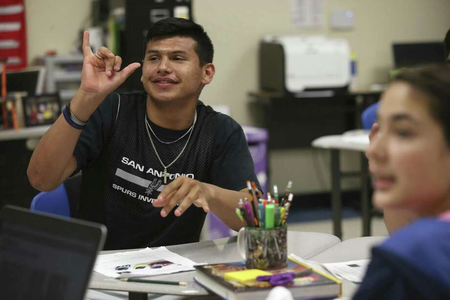 Deaf student Julian Farias, 17, answers a question during an English class at South San Antonio High School, Thursday, May 18, 2017. The South San Antonio ISD program for the deaf and hard of hearing is the hub for a dozen school districts in the southern region. Photo: JERRY LARA / San Antonio Express-News / © 2017 San Antonio Express-News