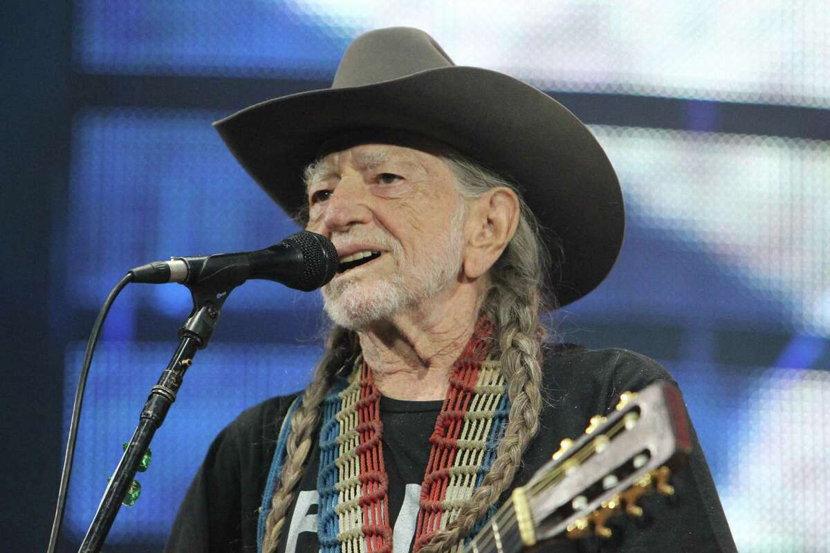 """Willie Nelson and his guitar """"Trigger"""" perform before a sold-out concert at RodeoHouston Saturday, March 18, 2017, in Houston. ( Steve Gonzales / Houston Chronicle )"""