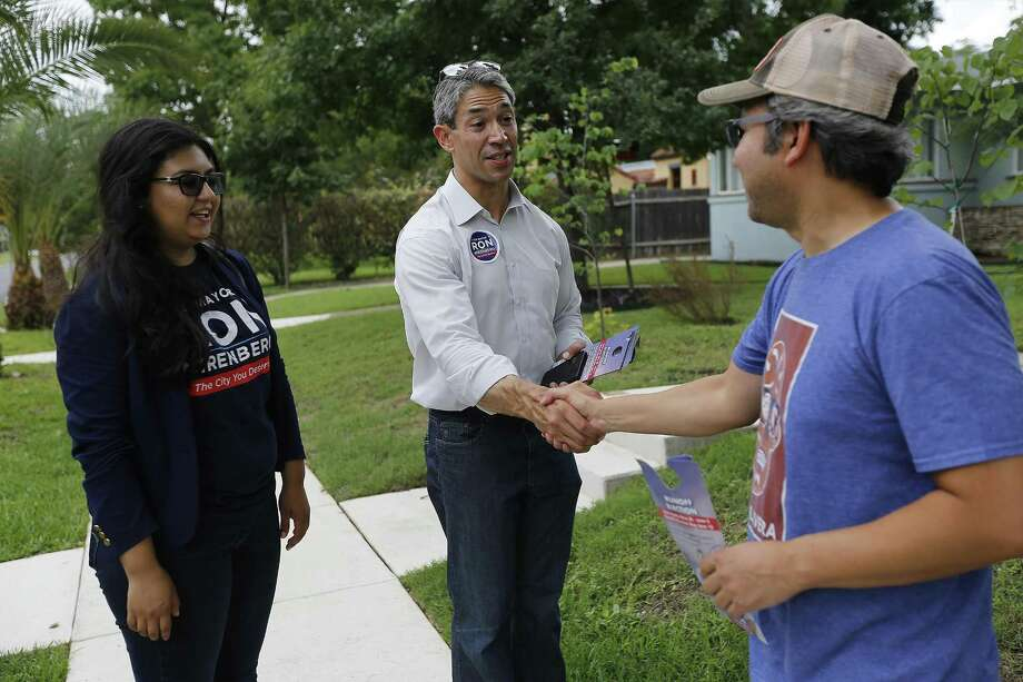 District 8 Councilman and mayoral candidate Ron Nirenberg (center) along with Deputy Campaign Manager Juany Torres (left) meet with Monticello Historic District homeowner John Hernandez while blockwalking in the neighborhood on Saturday, June 3, 2017. Nirenberg is in a runoff for the Mayor's office against current city mayor Ivy Taylor. (Kin Man Hui/San Antonio Express-News) Photo: Kin Man Hui, Staff / San Antonio Express-News / ©2017 San Antonio Express-News