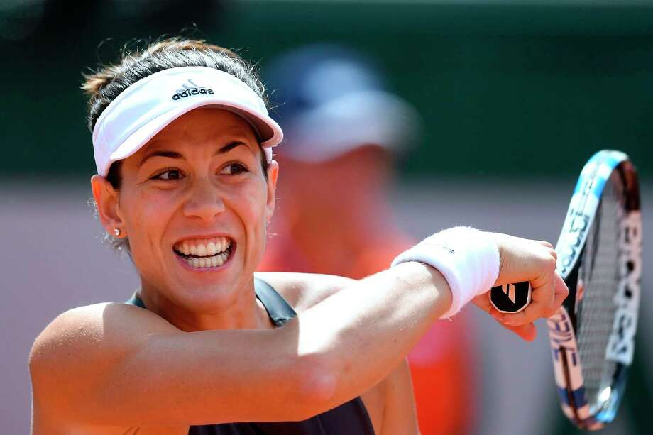 Spain's Garbine Muguruza returns the ball to France's Kristina Mladenovic during their tennis match at the Roland Garros 2017 French Open on June 4, 2017 in Paris.  / AFP PHOTO / FRANCOIS XAVIER MARITFRANCOIS XAVIER MARIT/AFP/Getty Images Photo: FRANCOIS XAVIER MARIT / AFP or licensors
