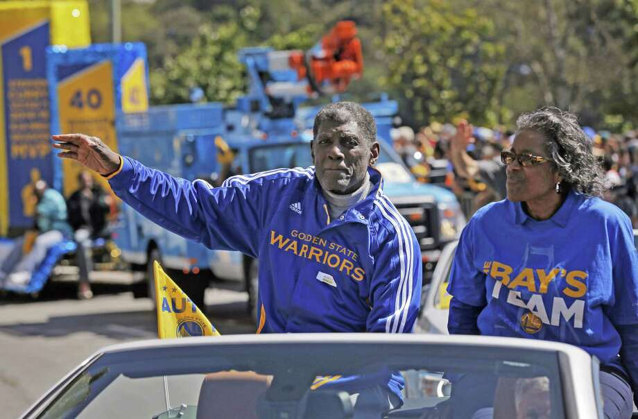 Warriors great Al Attles waves to the crowd on Lakeside Drive as the parade passes by on Friday. The Golden State Warriors celebrated their first NBA Championship in 40 years with a parade through Oakland, Calif.,  on Friday, June 19, 2015. Photo: Carlos Avila Gonzalez / The Chronicle / ONLINE_YES