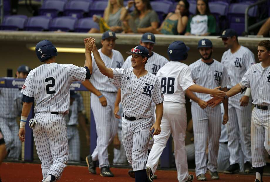 Rice's Tristan Gray (2) is greeted at the dugout after scoring an unearned run on a fielding error in the fifth inning of an NCAA college baseball tournament regional game against Southeastern Louisiana in Baton Rouge, La., Sunday, June 4, 2017. Rice won 9-5. (AP Photo/Gerald Herbert) Photo: Gerald Herbert/Associated Press