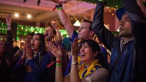 Warrior fan Neta Hamou of San Francisco (center) and friends watch the NBA Finals between the Golden State Warriors and Cleveland Cleveland Cavaliers at Paddy?s Pub during Colossal Clusterfest at Civic Center Plaza in San Francisco, June 4, 2017. (Peter DaSilva/Special to The Chronicle)