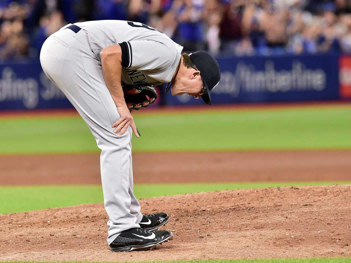 New York Yankees relief pitcher Tyler Clippard reacts on the mound after giving up a solo home run to Toronto Blue Jays third baseman Josh Donaldson during eighth inning American League baseball action in Toronto, Sunday, June 4, 2017. (Frank Gunn/The Canadian Press via AP) ORG XMIT: FNG516