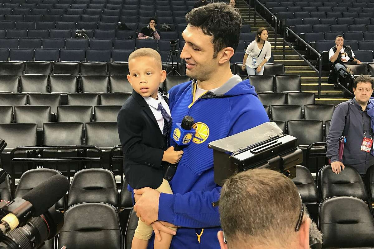 Young Trent Fuller, 4, with Zaza Pachulia at NBA Finals Media Day on Thursday, June 1. (Al Saracevic/San Francisco Chronicle)