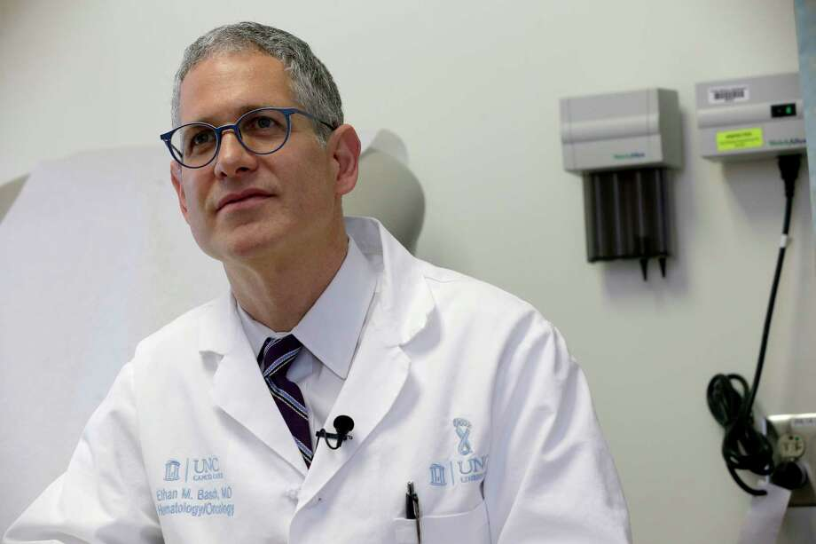 Dr. Ethan Basch speaks during an interview at the North Carolina Cancer Hospital in Chapel Hill, N.C., on Thursday, May 25, 2017. Basch conducted a study that shows cancer patients who use home computers to report problems like nausea and fatigue improved survival _ by nearly half a year, longer than many new cancer drugs do. (AP Photo/Gerry Broome) ORG XMIT: NY857 Photo: Gerry Broome / Copyright 2017 The Associated Press. All rights reserved.