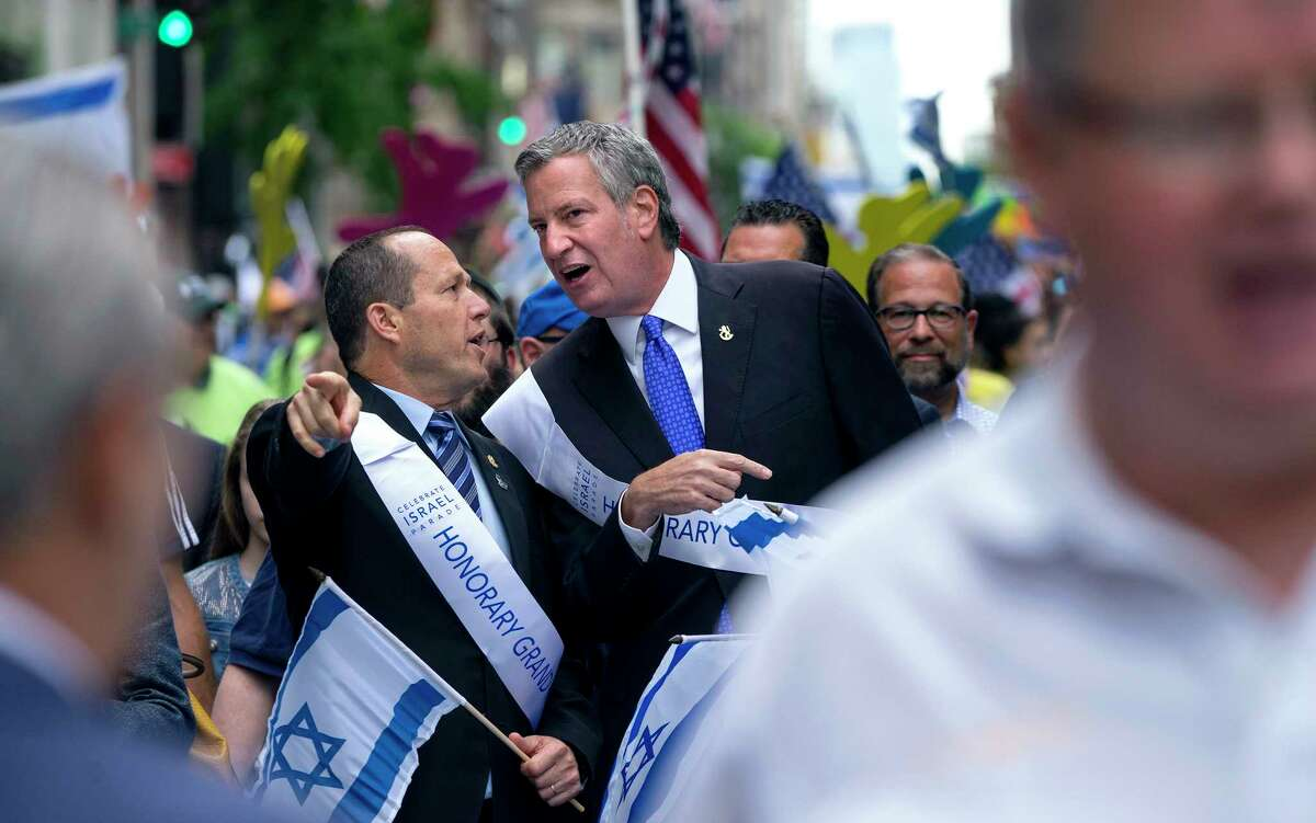 New York Mayor Bill De Blasio, center, speaks with Jerusalem Mayor Nir Barkat as they march along 5th Ave. during the 53rd annual Celebrate Israel Parade Sunday, June 4, 2017, in New York. (AP Photo/Craig Ruttle) ORG XMIT: NYCR106
