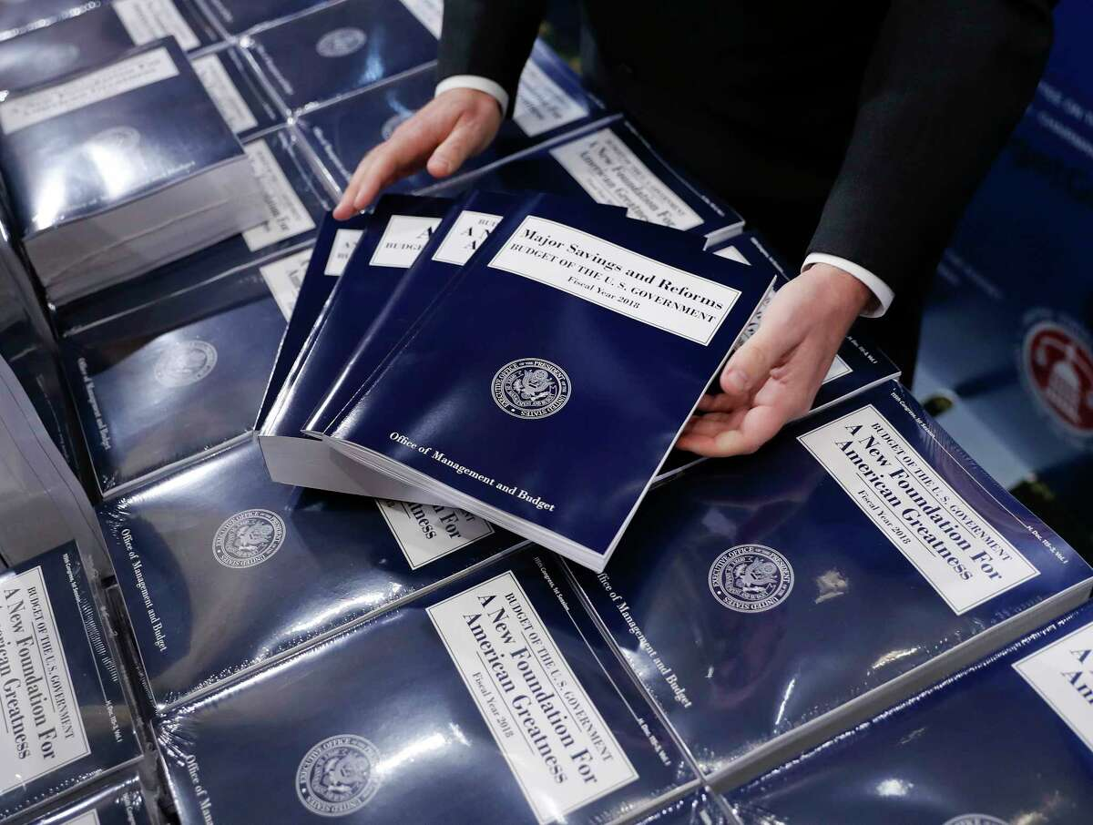 FILE - In this May 23, 2017 file photo, copies of President Donald Trump's fiscal 2018 federal budget are seen on Capitol Hill in Washington. Even members of his own party last month were quick to declare President Donald Trump?'s budget plan dead on arrival. And in fact, Congress faces a burst of overdue budget-related work this summer, most of which probably won?'t bear much resemblance to Trump?'s budget, which promised deep spending cuts on domestic programs, rapid economic growth, and a balanced federal ledger in a decade. (AP Photo/Pablo Martinez Monsivais, File) ORG XMIT: WX101