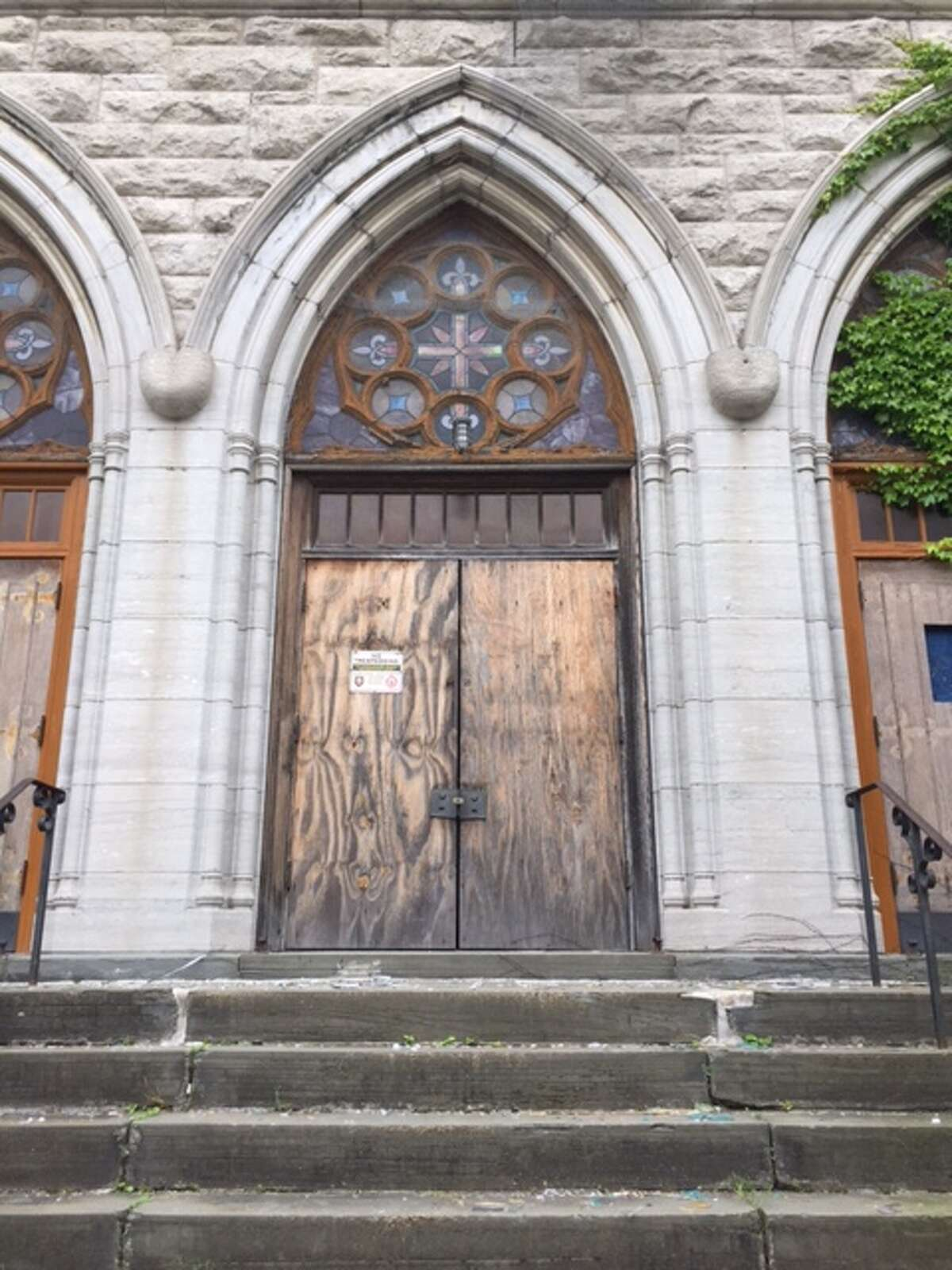 The former St. John's Catholic Church on Green Street in Albany remains vacant and decaying on Sunday, June 4, 2017. Its owner, World Unity Corp., previously had plans to rehabilitate the building into its headquarters, but the project never got off the ground. (Amanda Fries / Times Union)