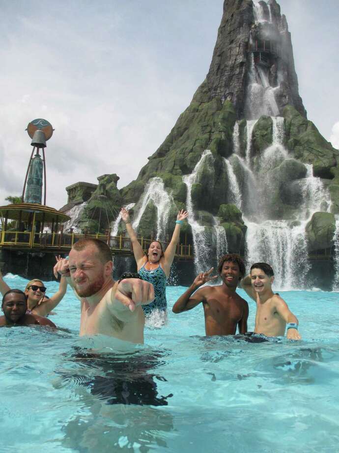 """Several water park junkies give Volcano Bay an """"awesome"""" rating. Visitors wear specially made wristbands that use technology to hold places in line — so you can have fun elsewhere instead of waiting in lines. Photo: Robin Soslow / For The Express-News"""