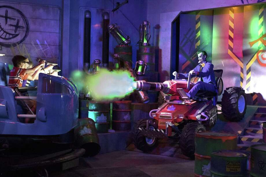 "This photo provided by Six Flags Over Georgia in Austell, Georgia, shows the new ""JUSTICE LEAGUE: Battle for Metropolis,"" a new immersive dark ride. The ride is opening at three Six Flags parks this season. In addition to Six Flags Over Georgia, it's opening at Six Flags Magic Mountain in Valencia, Calif., and Six Flags Great Adventure, in Jackson, N.J. Photo: Associated Press / Six Flags Over Georgia"