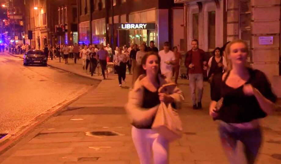 In this Saturday, June 3, 2017, image made from a video, people run from the scene an attack in London. Chaos broke out for several minutes during Saturday night's attack in the heart of the city, with people scattering in all directions, sometimes directly into the path of the men trying to kill them. (Sky news via AP) ORG XMIT: NYJK102 / Sky News
