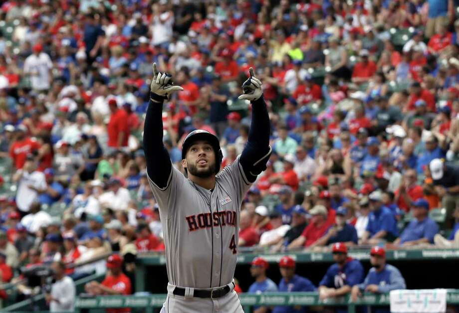 Houston Astros' George Springer celebrates hitting a solo home run in the fourth inning of a baseball game against the Texas Rangers on Sunday, June 4, 2017, in Arlington, Texas. The shot was Springer's second of the game. (AP Photo/Tony Gutierrez) Photo: Tony Gutierrez, STF / Copyright 2017 The Associated Press. All rights reserved.
