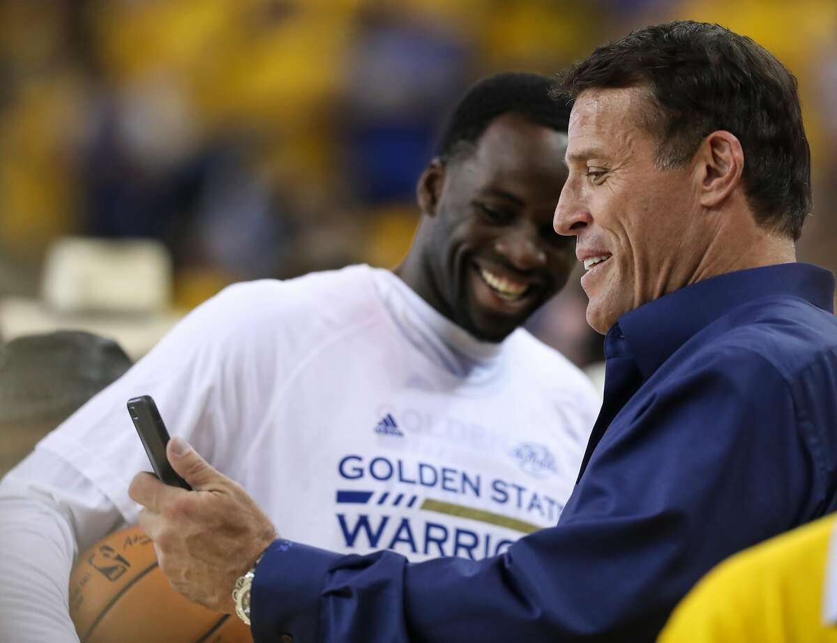 Golden State Warriors' Draymond Green and Tony Robbins chat prior to the start of Game 2 of the 2017 NBA Finals at Oracle Arena on Sunday, June 4, 2017 in Oakland, Calif.