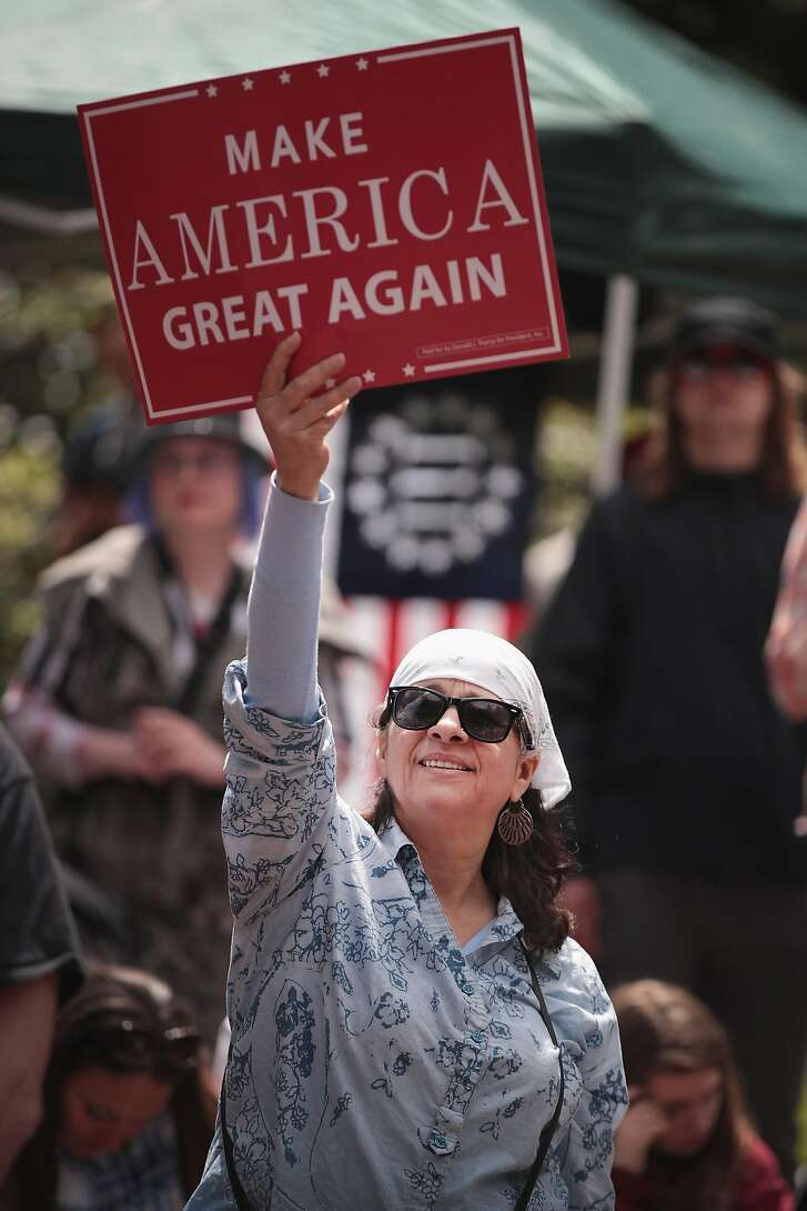 """PORTLAND, OR - JUNE 04:  Pro-Trump demonstrators rally on June 4, 2017 in Portland, Oregon. The protest dubbed """"Trump Free Speech"""" by organizers was met by a large contingent of counter-demonstrators who viewed the protest as a promotion racism. Many residents of Portland are still coming to terms with the recent violent attack on the city's MAX train line when Ricky Best, 53, and Taliesin Namkai-Meche, 23, were stabbed to death and Micah Fletcher,21, was severely injured after they tried to protect two teenage girls, one of whom was wearing a hijab, from being harassed with racial taunts by suspect Jeremy Christian.  (Photo by Scott Olson/Getty Images)"""