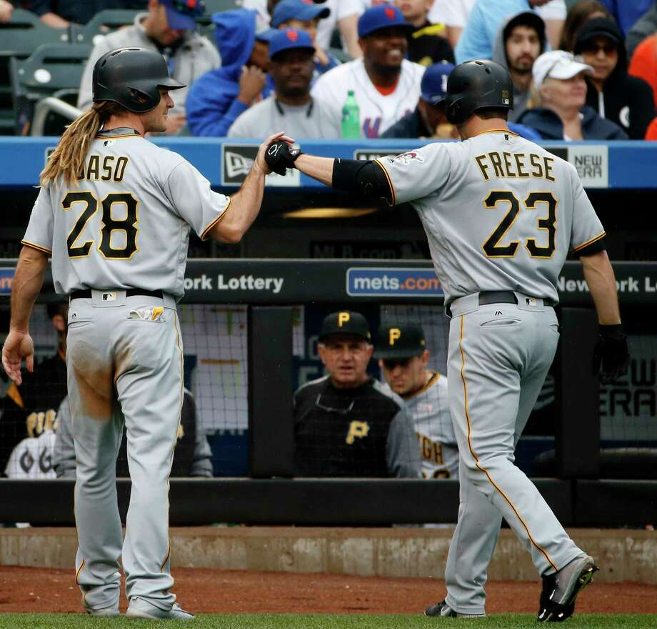 Pittsburgh Pirates John Jaso (28) celebrates with Pirates' David Freese (23) after scoring on Freese's third inning sacrifice fly in a baseball game against the New York Mets, Sunday, June 4, 2017, in New York. (AP Photo/Kathy Willens) ORG XMIT: NYM107 Photo: Kathy Willens / Copyright 2017 The Associated Press. All rights reserved.