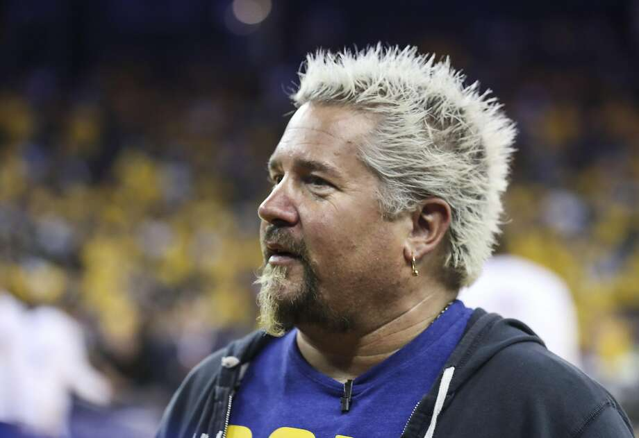 """Guy Fieri is seen during Game 2 of the 2017 NBA Finals at Oracle Arena on Sunday, June 4, 2017 in Oakland, Calif. A superfan has been following Fieri's show, """"Diners, Drive-Ins and Dives"""" and visited his 600th restaurant featured on the Food Network show. Photo: Scott Strazzante, The Chronicle"""