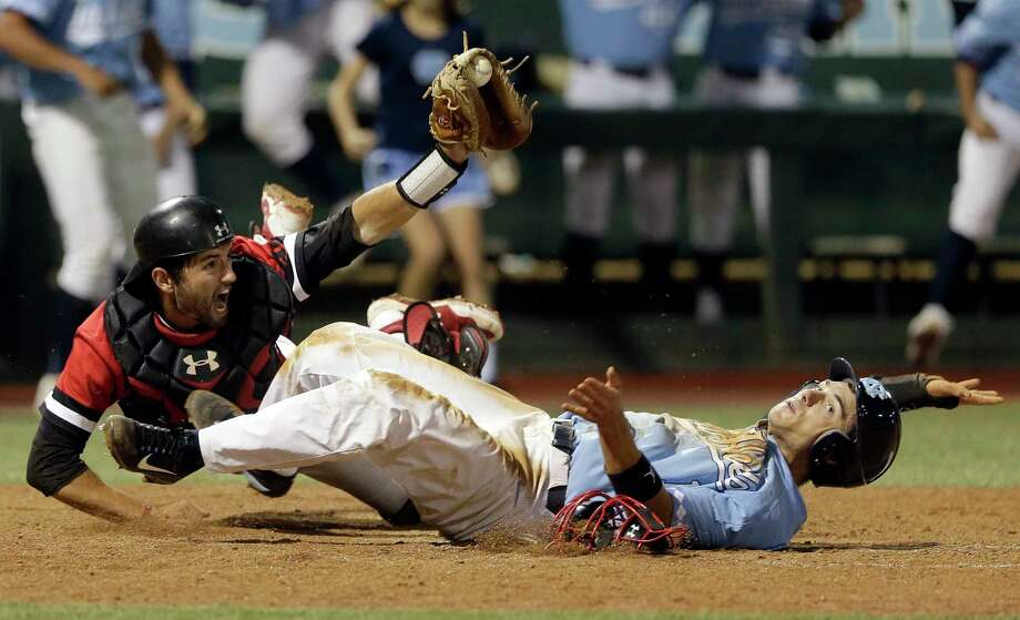 Davidson catcher Jake Sidwell reacts after making the tag on North Carolina's Brandon Riley at home plate during the ninth inning of an NCAA college baseball tournament regional game in Chapel Hill, N.C., Sunday, June 4, 2017. Riley was called out on the play. Davidson defeated North Carolina 2-1 to advance to the super regional. (AP Photo/Gerry Broome) ORG XMIT: NCGB115 Photo: Gerry Broome / Copyright 2017 The Associated Press. All rights reserved.