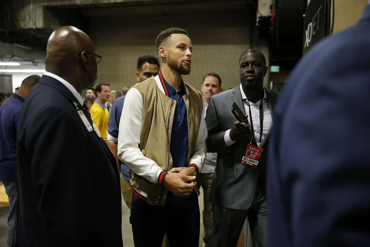 Golden State Warriors guard Stephen Curry (30) exits a news conference following Game 2 of the NBA Finals between the Golden State Warriors and the Cleveland Cavaliers on Sunday, June 4, 2017, at Oracle Arena in Oakland, Calif.