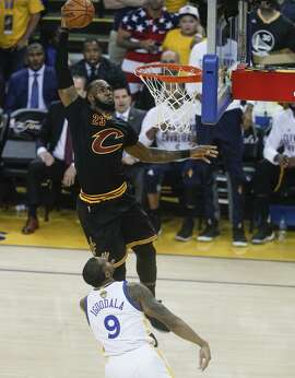 LeBron James, dunking over the Warriors' Andre Iguodala, had 29 points, 14 assists and 11 rebounds in Game 2 for triple-double, tying Magic Johnson for the record for the most in the NBA Finals with eight.