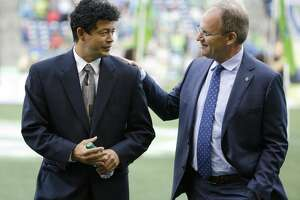 Seattle Sounders head coach Brian Schmetzer, right, talks with Houston Dynamo head coach Wilmer Cabrera, left, before an MLS soccer match, Sunday, June 4, 2017, in Seattle. (AP Photo/Ted S. Warren)