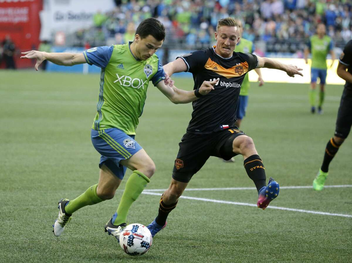 Seattle Sounders midfielder Aaron Kovar, left, is pressured by Houston Dynamo defender Dylan Remick, right, in the second half of an MLS soccer match, Sunday, June 4, 2017, in Seattle. The Sounders won 1-0. (AP Photo/Ted S. Warren)