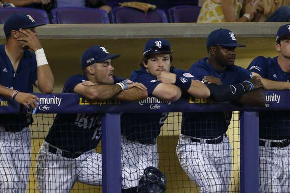 The Rice dugout watches during the ninth inning of an NCAA college baseball tournament regional game against LSU in Baton Rouge, La., Sunday, June 4, 2017. LSU won 5-0 to advance to the Super Regionals. (AP Photo/Gerald Herbert)