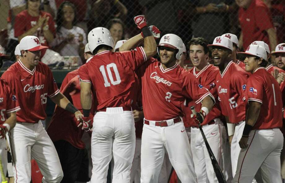 Houston catcher Connor Wong (10) celebrates his game-winning single home run with the Cougars dugout during the top ninth inning of the 2017 NCAA Regional Game 5 against Iowa at Darryl and Lori Schroeder Park Sunday, June 4, 2017, in Houston. Houston Cougars defeated Iowa Hawkeyes 7-5. ( Yi-Chin Lee / Houston Chronicle ) Photo: Yi-Chin Lee/Houston Chronicle