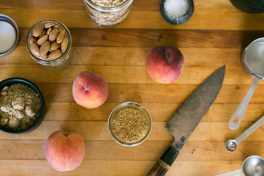 Cutting board with ingredients for cooked peaches and toppings for Kristen Rasmussen's porridge. Photo: Jen Fedrizzi, Special To The Chronicle