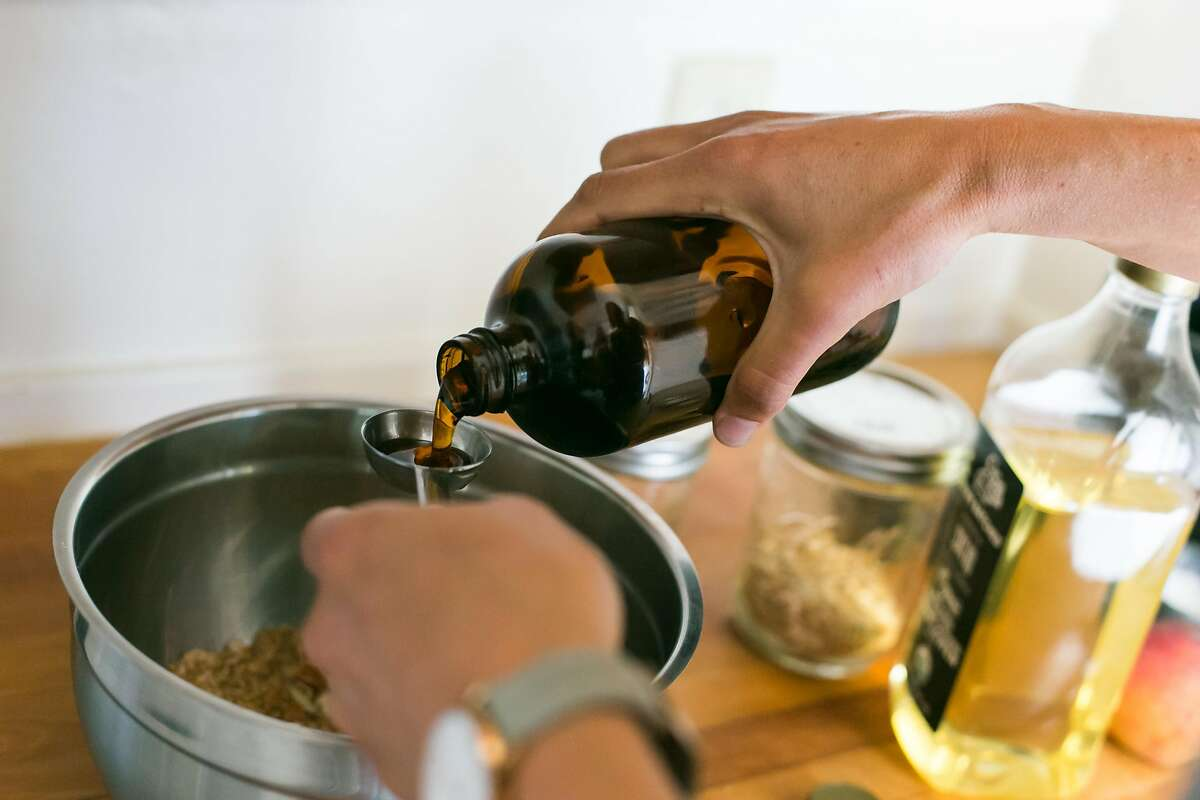 Kristen Rasmussen measures out maple syrup for baked oats that will top the porridge.