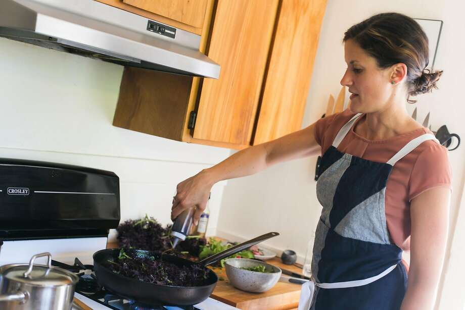 Kristen Rasmussen cooks down red mustard frills for a savory porridge. Photo: Jen Fedrizzi, Special To The Chronicle