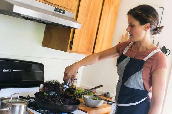 Kristen Rasmussen cooks down red mustard frills for a savory porridge.