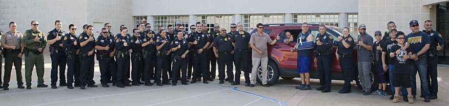 Officials welcome home wounded officers Mario Cásares and Arturo Vela at LPD headquarters on Sunday. Photo: Foto Por Francisco Vera|Laredo Morning Times