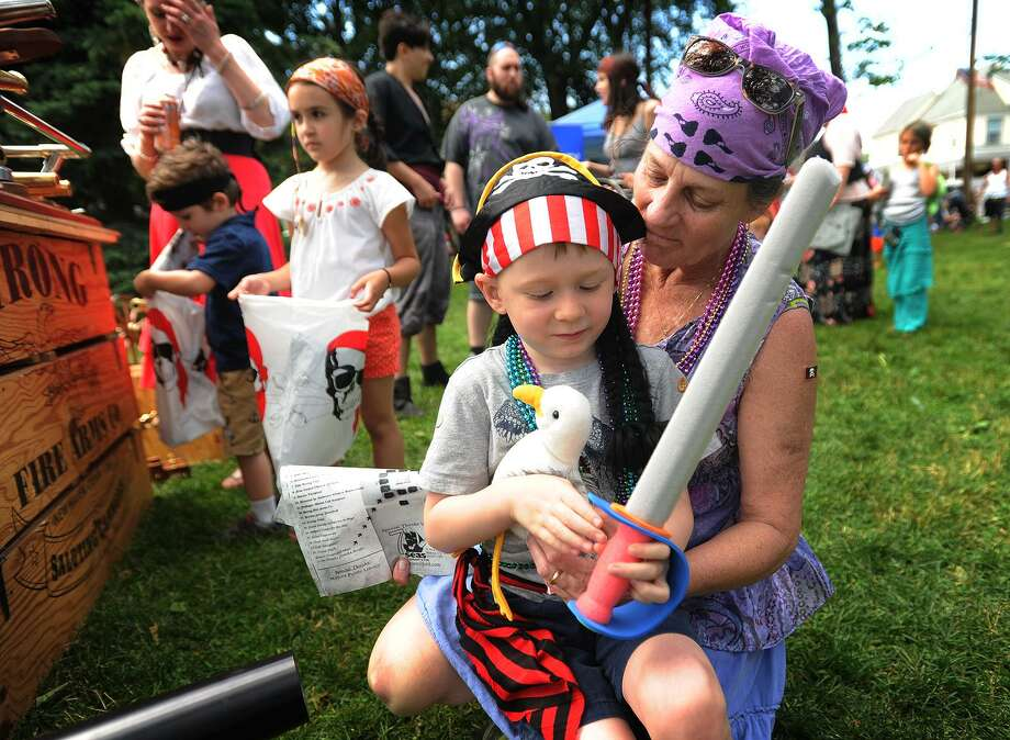 Tyler Dupree, 5, and his grandmother Lisa Riley, both of Milford, dress as pirates for the 2016 Pirates Day on the Green in Milford, Conn. on Sunday, June 12, 2016. The annual event, set for June 10 & 11, will feature a variety of pirate-themed activities for children and their families. Photo: Brian A. Pounds / Hearst Connecticut Media / Connecticut Post