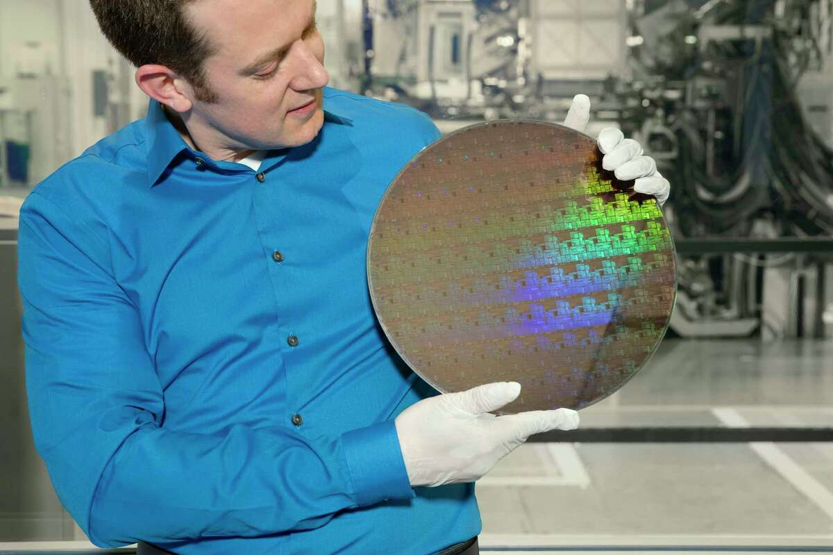 A silicon wafer with 5 nanometer transistors made at SUNY Poly in Albany held by Nicolas Loubet of IBM Research