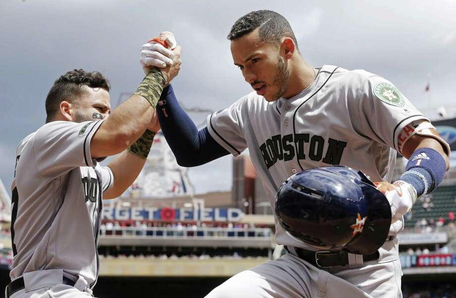 Carlos Correa celebrates a May 29 homer. Photo: Jim Mone /Associated Press / Stratford Booster Club