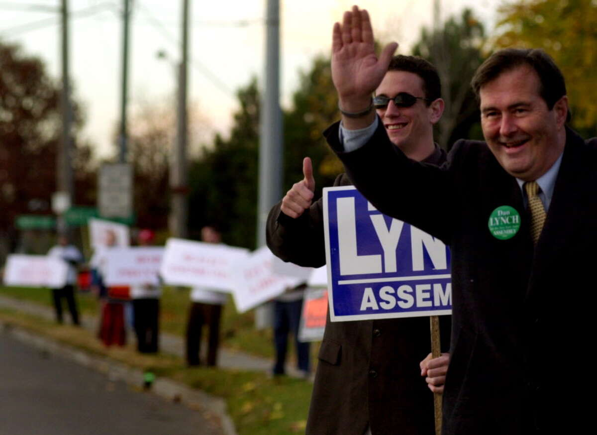Dan Lynch, right, running for the 107th-district Assembly seat, campaigns with campaign member Luke Canfora, second from right, on Tuesday, Nov. 7, 2000, on Central Avenue in Colonie, N.Y. (Cindy Schultz/Times Union)