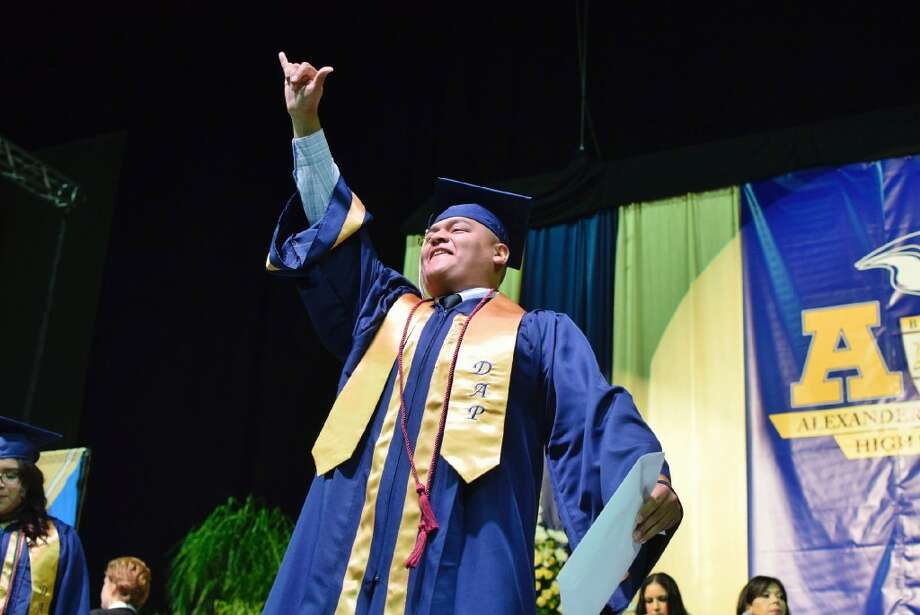 Alexander High School student celebrates after receiving their diploma during the 2017 Alexander High School Commencement Ceremony held at the LEA Saturday May 03, 2017. Photo: Ulysses S. Romero/Laredo Morning Times
