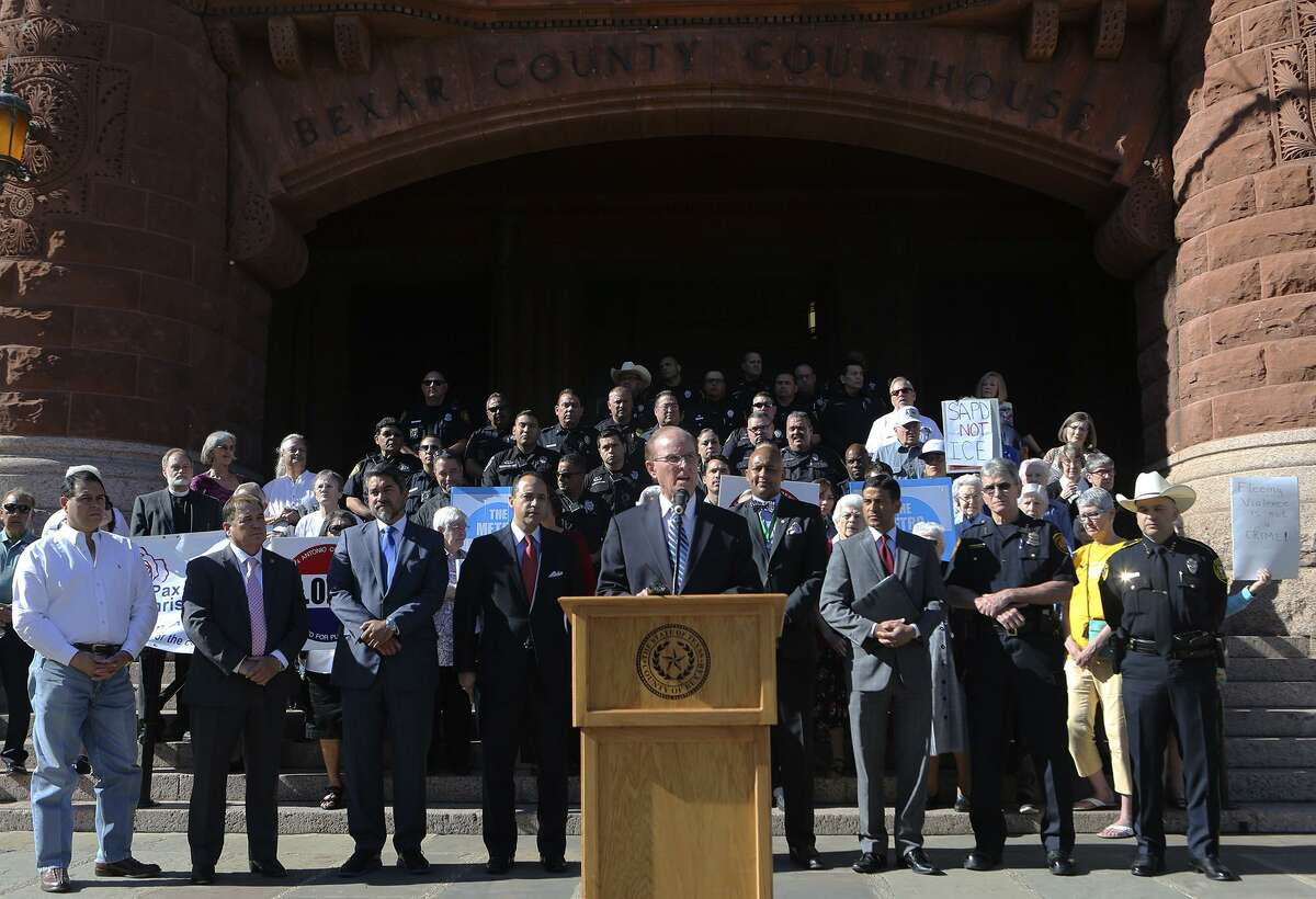 """Bexar County Judge Nelson Wolff (at lectern) speaks out against Senate Bill 4 Friday May 5, 2017 in front of the Bexar County courthouse. Wolff and other public leaders such as Bexar County sheriff Javier Salazar, District Attorney Nico LaHood and Senator Jose Menendez were on hand to voice their disapproval of the bill. The bill would allow police to ask the immigration status of anyone detained and started out as a means to punish so-called """"sanctuary cities."""" Wollf said the bill is institutional racial profiling."""