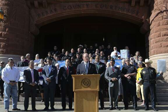 "Bexar County Judge Nelson Wolff (at lectern) speaks out against Senate Bill 4 Friday May 5, 2017 in front of the Bexar County courthouse. Wolff and other public leaders such as Bexar County sheriff Javier Salazar, District Attorney Nico LaHood and Senator Jose Menendez were on hand to voice their disapproval of the bill. The bill would allow police to ask the immigration status of anyone detained and started out as a means to punish so-called ""sanctuary cities."" Wollf said the bill is institutional racial profiling."