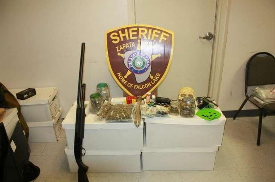 This photo shows the firearms and narcotics that were found in a home in the Lake Falcon Estates.   Photo: Zapata County Sheriff's Office