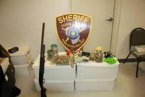 This photo shows the firearms and narcotics that were found in a home in the Lake Falcon Estates.
