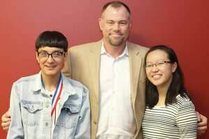 Pearland High School student Andrew Aguilar (left) and Dawson High School student Helen Wang (right) were awarded with a Rating IV-Superior in the state VASE competition. Pictured with Aguilar and Wang is Pearland High School art teacher Ben Stiles.